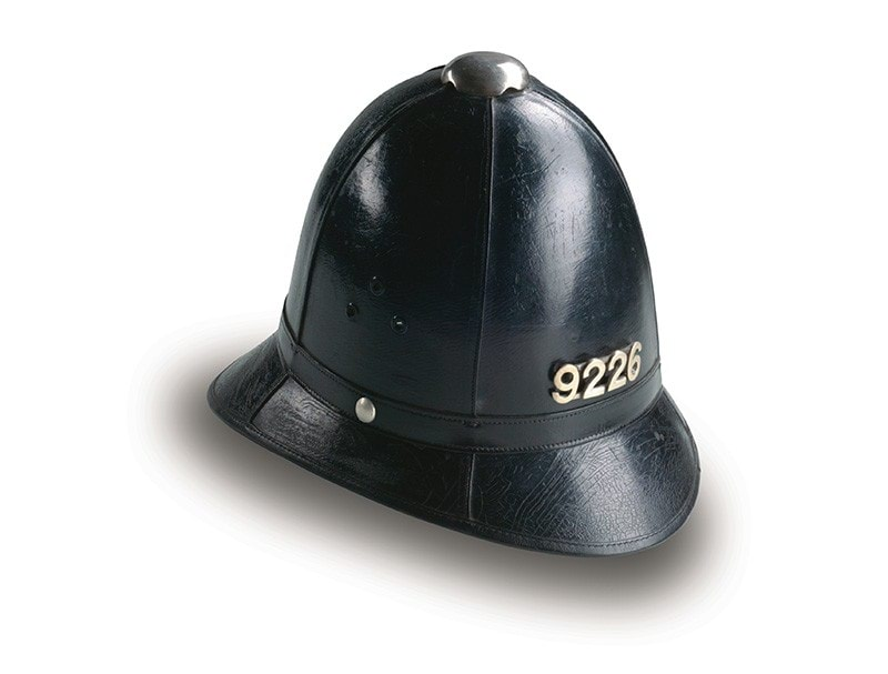 Photo of old Black Bobby police helmet from 1877
