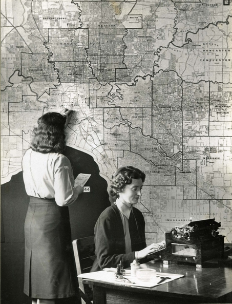 Photo of policewomen against a map of Melbourne